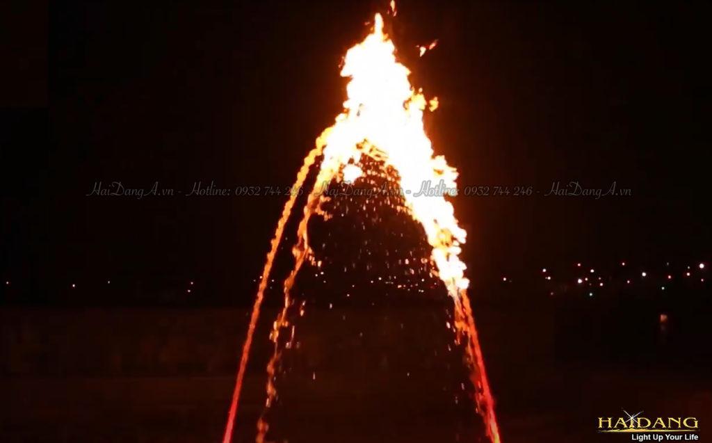 Hai vòi nước cầu vồng chụm vào nhau và lửa cháy trên hai vòi này